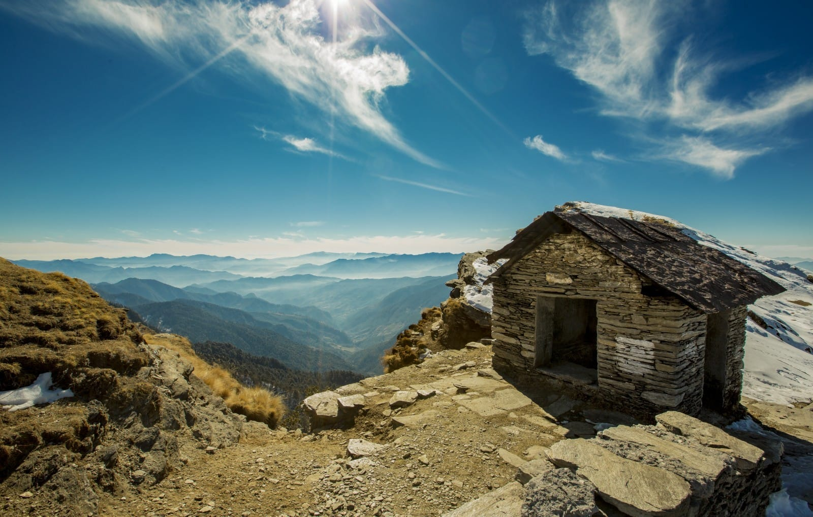 stone-hill-mountain-huts-sky